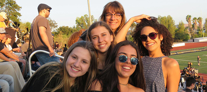 Oak Park international students enjoy a friday night football game.